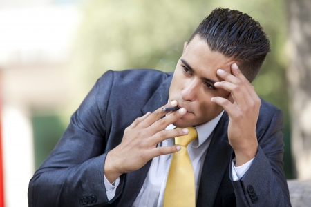 smoking cigar: frustrated businessman smoking a cigar to relax Stock Photo