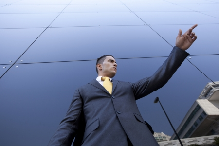 directly below: Confident young businessman next to his office building Stock Photo