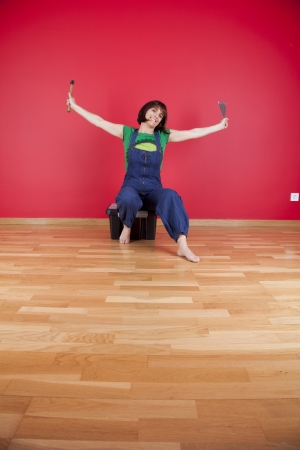woman relaxing at her house after reparing her red wall photo