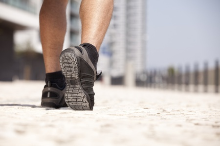 training shoes: Athlete man shoes running in the city (selective focus) Stock Photo