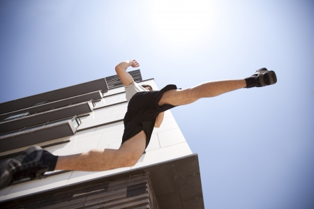 air jump: Men athlete running in the city (bellow angle with some motion blur)