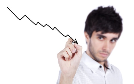 drawing arrow: Happy businessman drawing a decline profit chart on the whiteboard (selective focus)