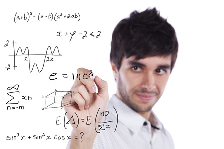 mathematical symbol: mathematics teacher writing formulas on the whiteboard (selective focus)