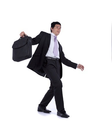 Businessman with slow walking with fear from falling (isolated on white) photo