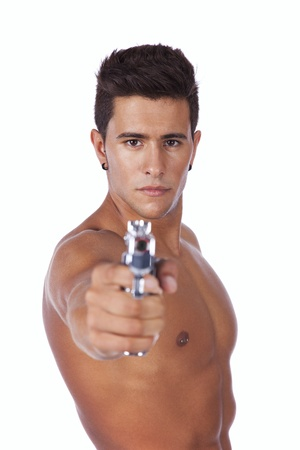Powerful young man with a gun pointing to you Stock Photo - 16387267