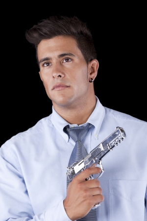 Powerful businessman with a gun (isolated on black) Stock Photo - 16389169