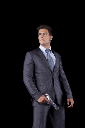 Powerful businessman with a gun (isolated on black) Stock Photo - 16387463