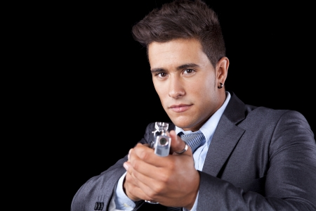 Powerful businessman with a gun (isolated on black) Stock Photo - 16388806