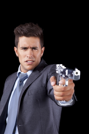 Powerful businessman with a gun (isolated on black) Stock Photo - 16389051