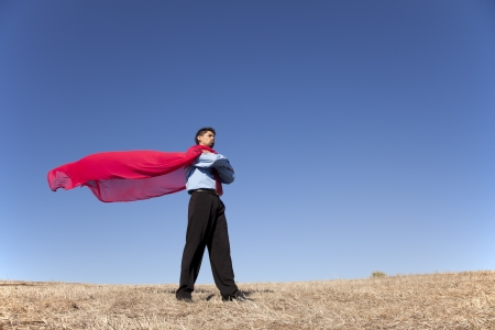 Businessman with a red flying cape like superman photo