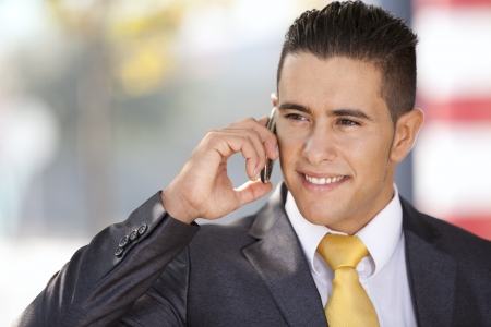 Successful and handsome businessman talking at his cellphone photo