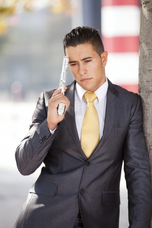 Stressed businessman with a gun pointing to his head  photo