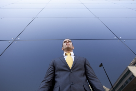 Confident young businessman next to his office building Stock Photo - 16388552