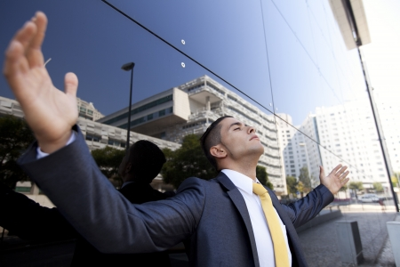 Confident young businessman next to his office building Stock Photo - 16388809