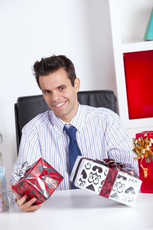 Happy businessman at his office giving valentine day gifts Stock Photo - 16388603