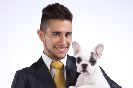 Happy businessman holding his puppy dog, a Boston Terrier photo