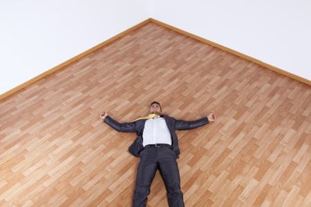 young businessman fainted on the office floor photo