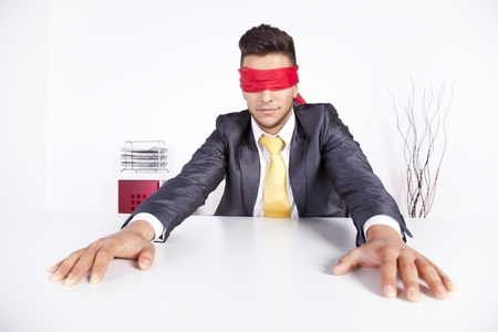 Businessman at his office with scarf covering his eyes Stock Photo - 16387263
