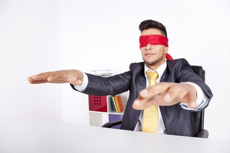 Businessman at his office with scarf covering his eyes Stock Photo - 16387078