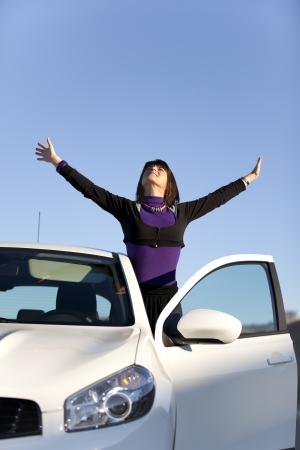 Beautiful woman enjoying her new car
