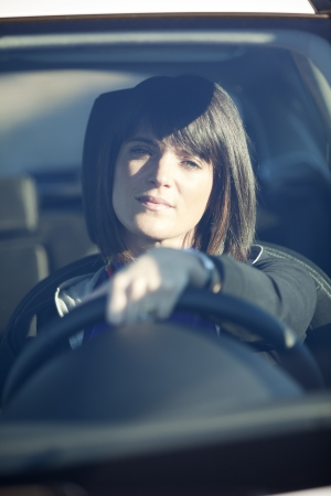 Beautiful woman driving her new white car Stock Photo - 16492582