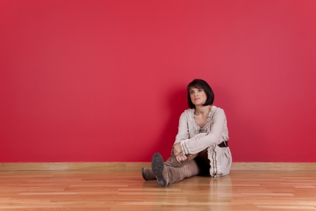 mature women sited in the floor of his new house Stock Photo - 16389162