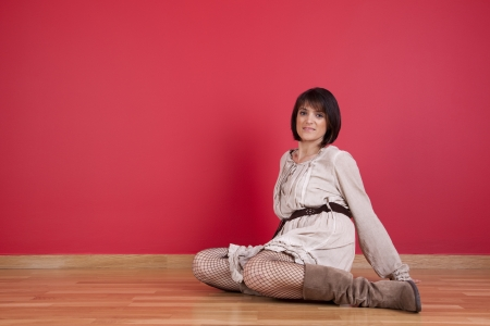 mature women sited in the floor of his new house Stock Photo - 16389096