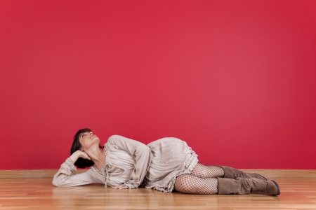 happy mature women laying down in the floor of his new house Stock Photo - 16389092