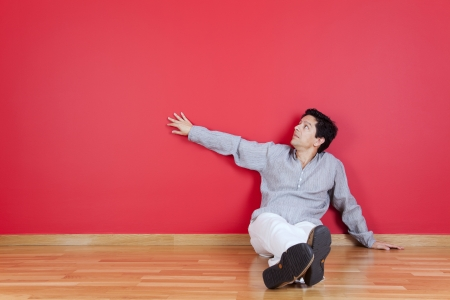 young men relaxing in the floor of his new house Stock Photo - 16389192