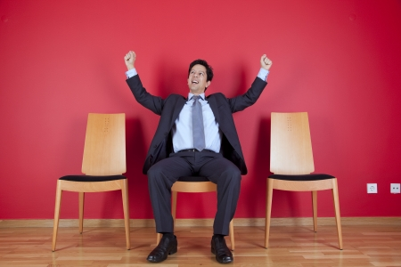 One successful businessman between two empty chairs Stock Photo - 16389206