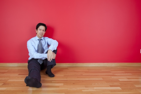 businessman sited in the floor of his new house Stock Photo - 16389203