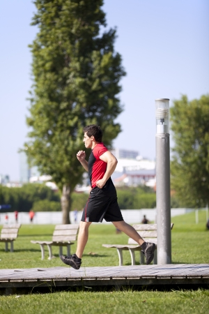 Men athlete running at the city park photo