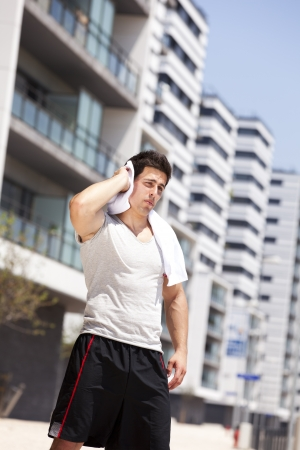 Athlete man tired after a long running sport event in the city photo
