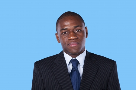 African businessman portrait (blue background) photo