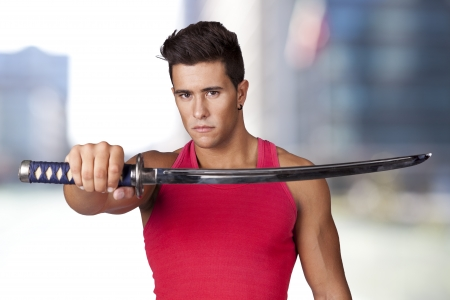 Young warrior holding a ninja sword