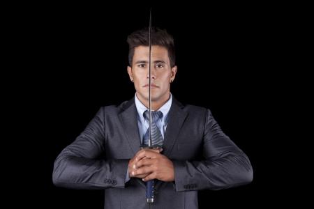 ninja weapons: Powerful businessman holding a ninja sword (isolated on black)