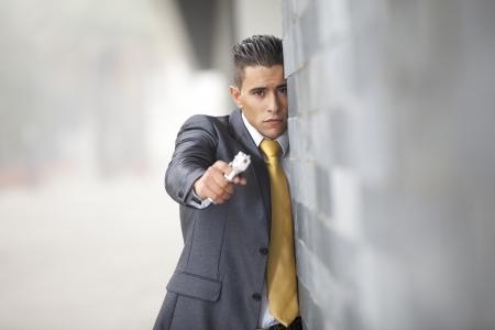 Powerful security businessman aiming a gun  photo
