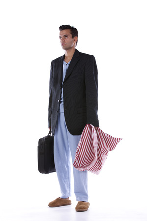 Businessman dress with nightclothes (isolated on white) photo
