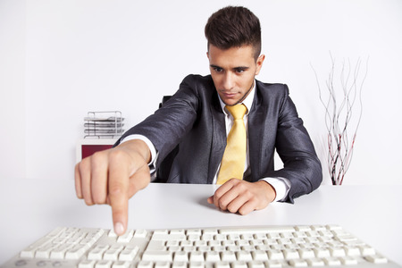 office use: Businessman at his office typing at the computer keyboard