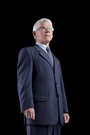 Powerful businessman portrait (isolated on black) photo