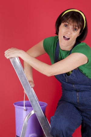 step ladder: Woman at her house cleaning