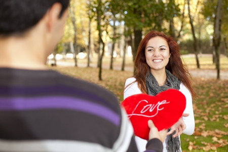 Love and affection between a young couple at valentine day (selective focus with shallow DOF) photo