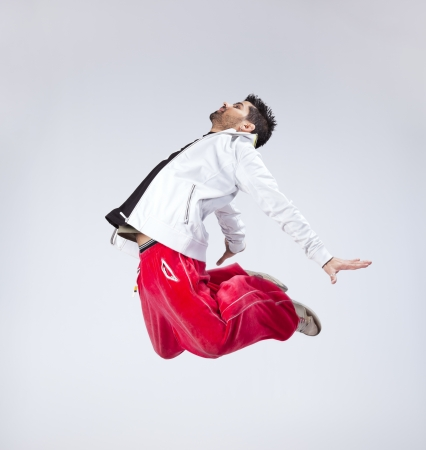only men: Hip hop dancer showing some movements (some motion blur)