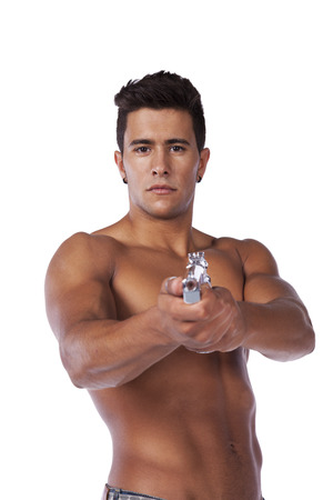 Powerful young man with a gun (isolated on white) photo