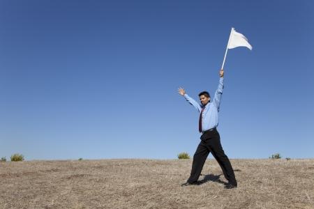 surrender: businessman asking for surrendering holding a white flag