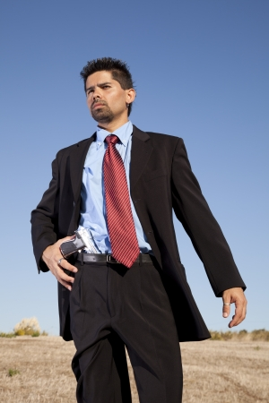 murderer: Powerful businessman with a gun in outdoor Stock Photo