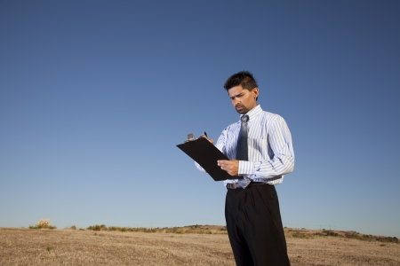 Successful businessman holding a notepad in outdoor photo