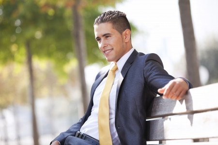 sitted: Handsome businessman sitted at the bench park