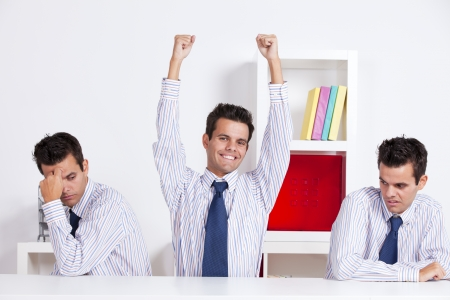 clone: One successful businessman between two jealous businessman Stock Photo