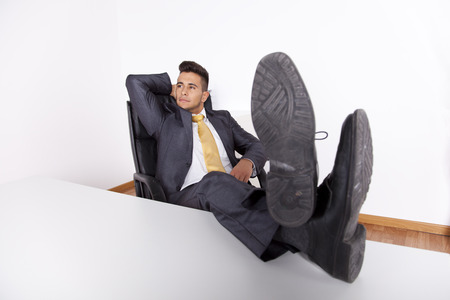 Businessman taking a break at his office photo
